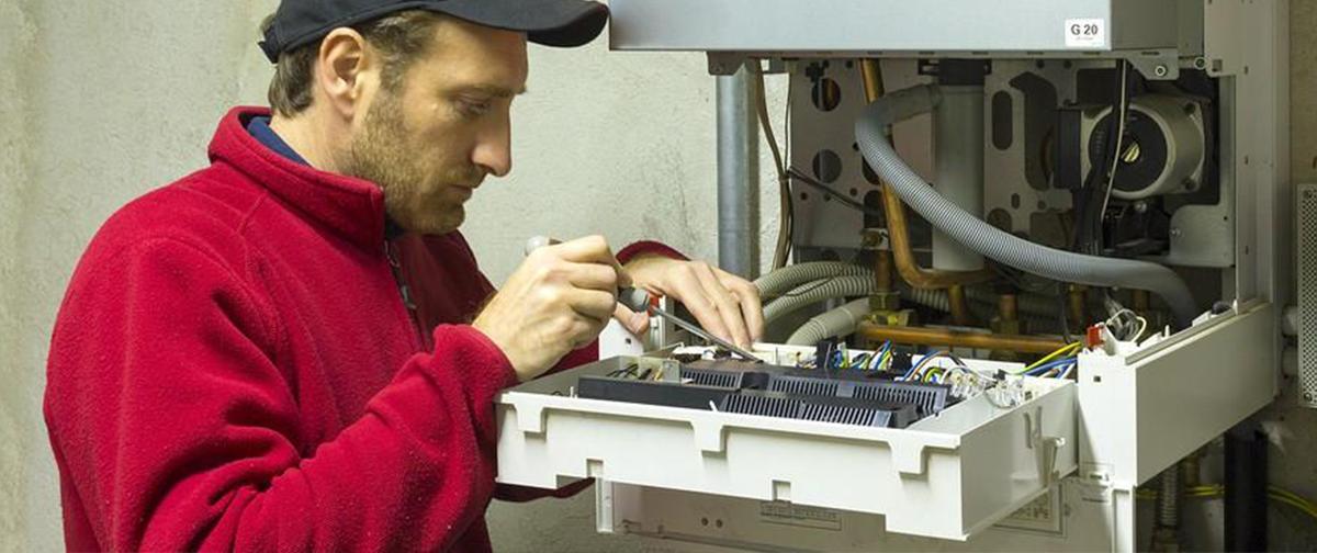 Gas Safe Engineer working on boiler