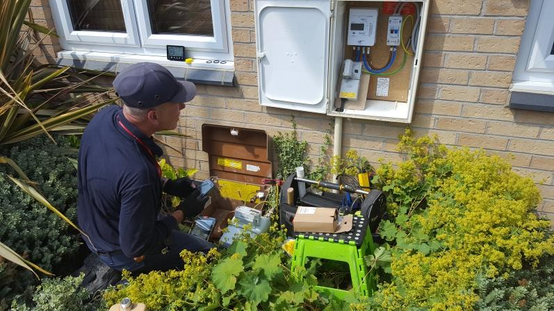 Scottish Power engineer installing a smart gas and smart electricity meter