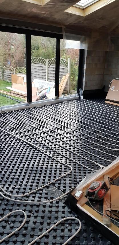 Underfloor heating loops being laid