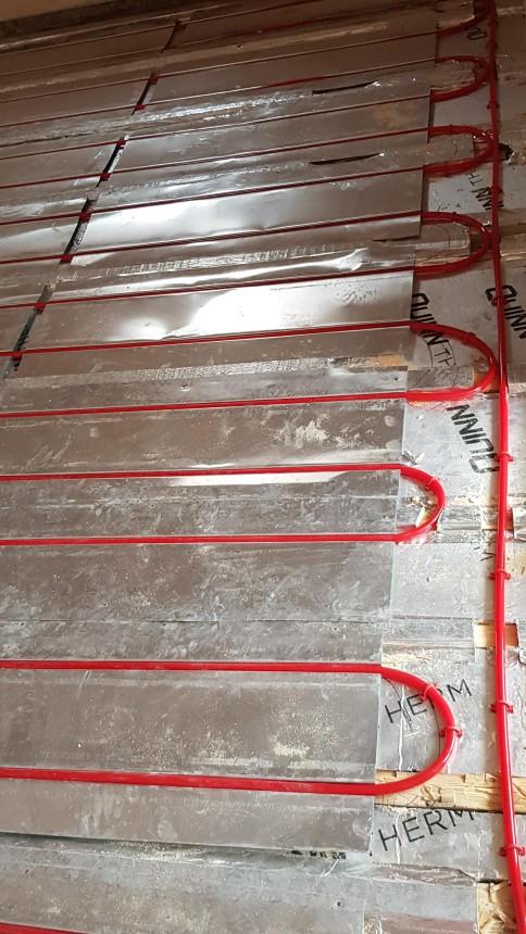 Underfloor heating on a wooden 1st floor bedroom