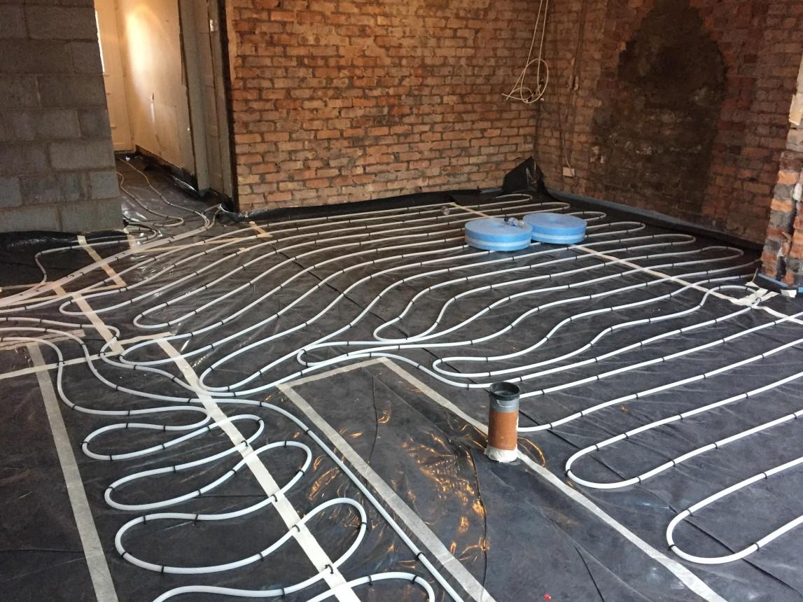Under floor pipe work