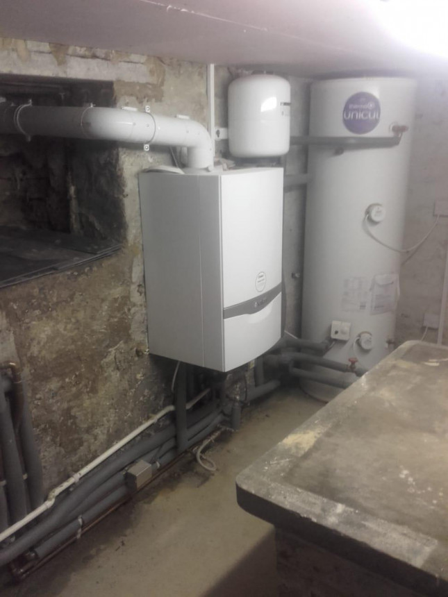 System boiler in cellar with unvented cylinder